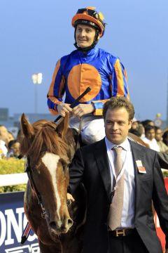 Daddy Long Legs mit Colm O'Donoghue nach dem Sieg im UAE Derby 2012. www.galoppfoto.de