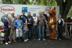 Siegerehrung mit Jockey Norman Richter, Trainer Chr. M. Wolters. Foto: Suhr